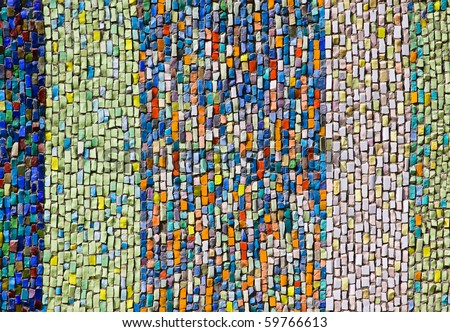 Vertical colorful mosaic texture on the wall - stock photo