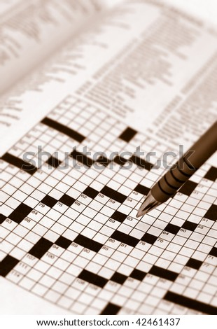 Vertical Crossword Composition with Pen in Sepia Tones - stock photo