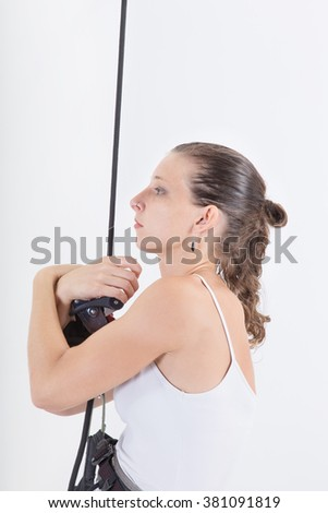 Vertical dance. girl dressed executive with harnesses hanging from a climbing rope