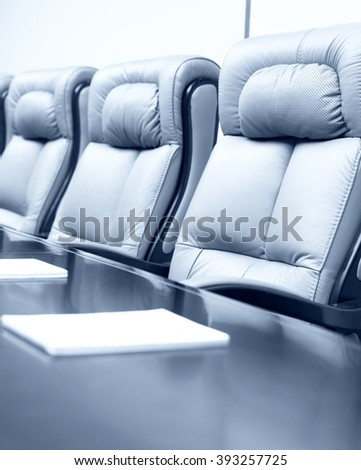 Vertical empty corporate conference room before business meeting in office, blue tone - stock photo