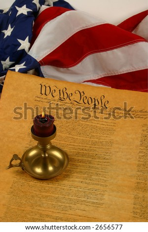 Vertical flag, constitution, and candle -- United States - stock photo