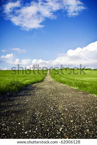 Vertical Green field Landscape with country road - stock photo