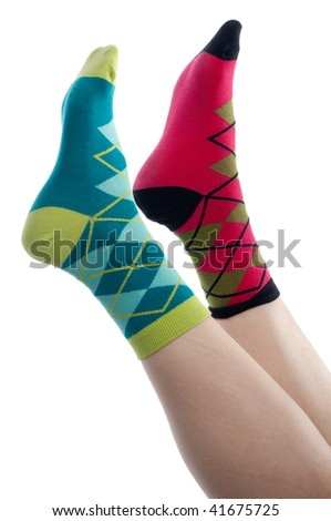 vertical image brightly colored socks  on a white background - stock photo