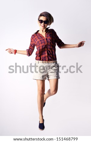 Vertical image of a modern beauty posing while jumping - stock photo
