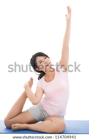 Vertical image of a sportive girl doing stretching exercises - stock photo
