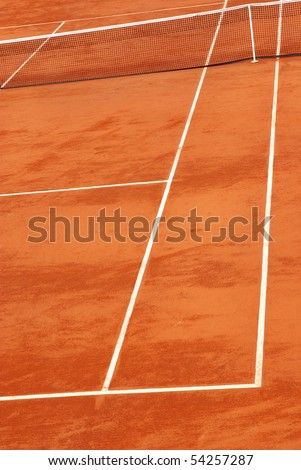 Vertical image of a tennis court in clay. - stock photo