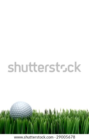 Vertical image of a white golf ball in green grass on a white background with space for copy