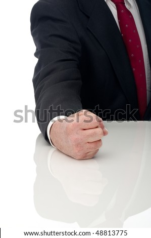 Vertical image of an angry business man banging fist on table - stock photo
