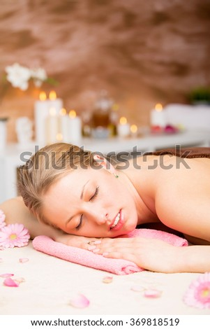 Vertical image of beautiful woman relaxing at spa treatment