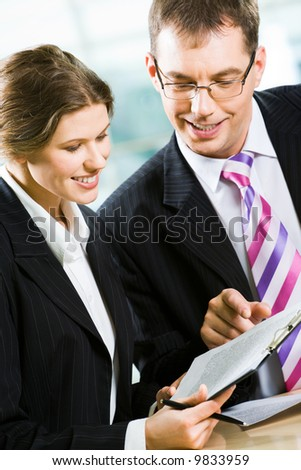 Vertical image of business partners working in the office together - stock photo