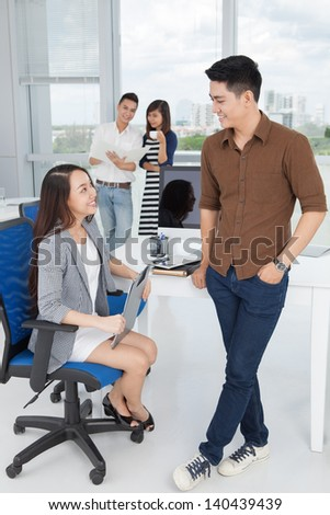 Vertical image of businesspeople discussing a new idea at the office - stock photo