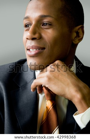 Vertical image of confident businessman looking forwards - stock photo