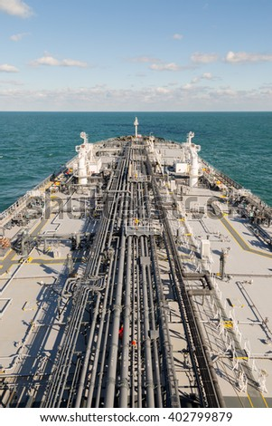 Vertical image of deck of the crude oil tanker - stock photo