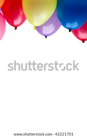 Vertical image of floating colorful party balloons with copy space - stock photo