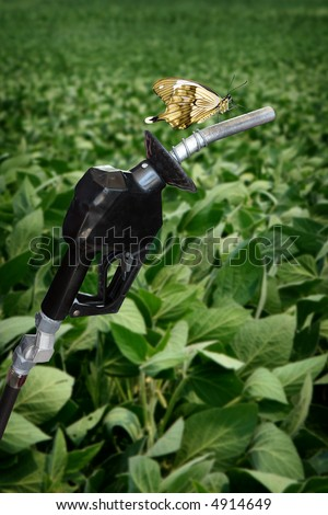 vertical image of gasoline nozzle with butterfly - stock photo