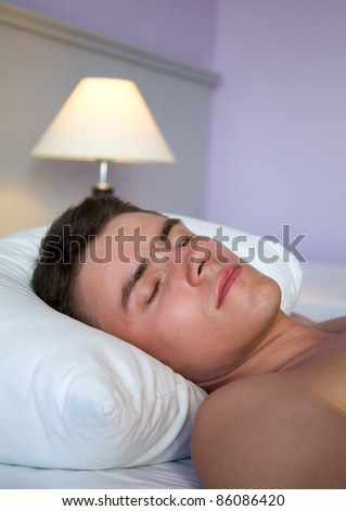 Vertical image of handsome man sleeping - stock photo
