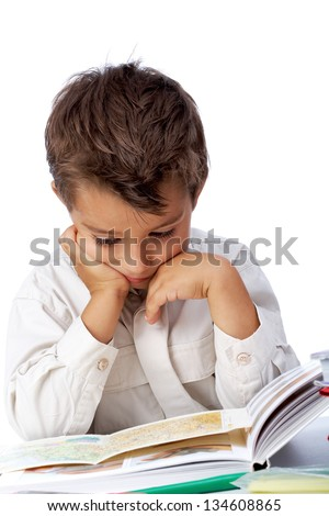 Vertical image of interested schoolkid reading book in isolation - stock photo