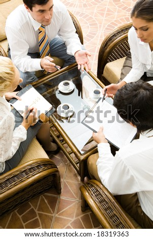 Vertical image of people interacting together at meeting - stock photo