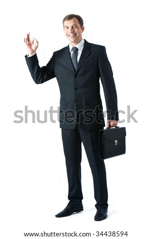 Vertical image of successful boss standing in studio - stock photo