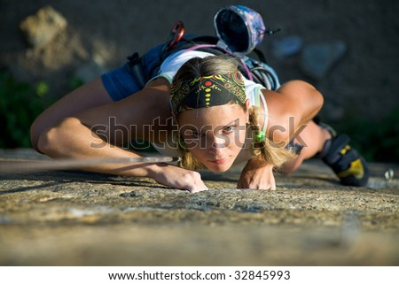 Vertical image of woman doing exercise on the mountain - stock photo
