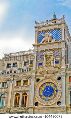 Vertical image old clock on the tower in Venice, made from the bottom up. - stock photo