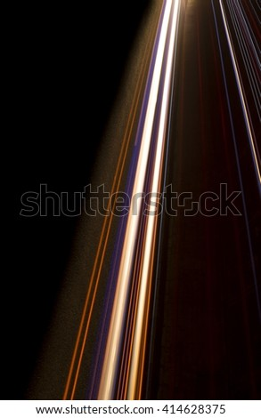 vertical interesting and abstract lights in orange, red, yellow and white that can be used as background or texture - stock photo