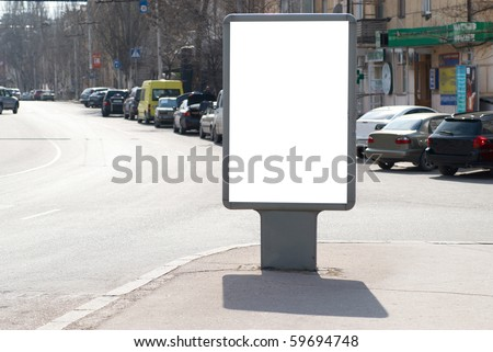 Vertical Isolated blank billboard on the city street