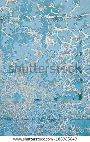 vertical orientation close up of a vintage metal surface, with layers of cracking paint, in a porcelain blue color, with copy space / Vintage Distressed Metal Surface - Vertical - stock photo