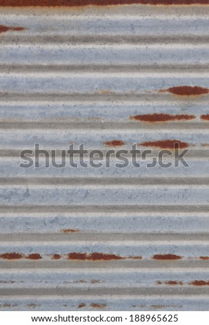 vertical orientation close up of a worn, metal panel with rust spots and copy space / Rusty Background - Vertical - stock photo