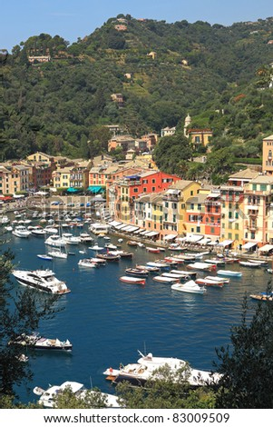 Vertical oriented image of famous town of Portofino with small bay full of yachts and boats on Ligurian sea, northern Italy.