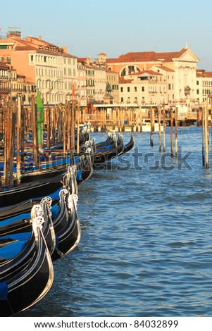 Vertical oriented image of gondolas on Grand Canal in Venice, Italy. - stock photo