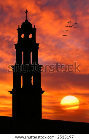 Vertical oriented image of the old church silhouette on beautiful sunset sky with red clouds and sun in Yafo, Israel. - stock photo