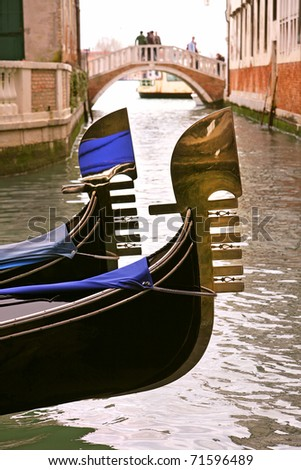 Vertical oriented image of two gondolas on canal in Venice, Italy. - stock photo