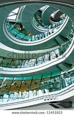 Vertical oval stairway in the middle of building - stock photo