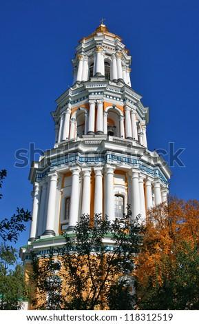 Vertical panorama of Great Bell Tower of Pechersk Lavra monastery in Kiev, Ukraine. Built in 1731-1745. UNESCO world heritage. - stock photo