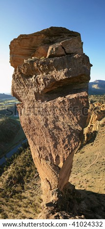 vertical panorama of monkey face rock spire as seen from the adjacent rim, Smith Rock State Park, Oregon - stock photo