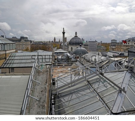 Vertical panoramic view of London rooftops featuring the National Gallery in the foreground, Nelson's column, Trafalgar Square and the Houses of Parliament in the background. England, United Kingdom.  - stock photo