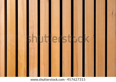 Vertical pattern in wood wall, light and dark stripes, horizontal image