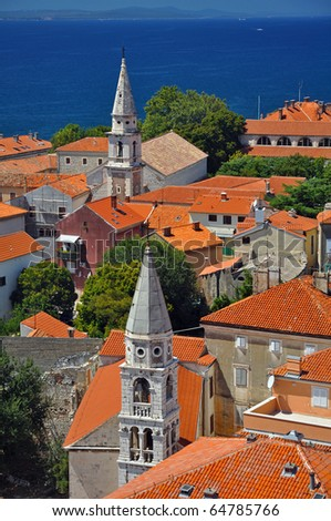 vertical photo of ancient town of Zadar with two church towers, Croatia - stock photo