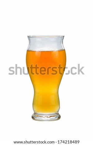 Vertical photo of beer in tall curved shaped glass isolated on white background