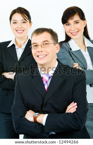 Vertical photo of business team with confident leader at the front - stock photo