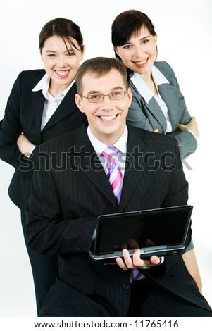 Vertical photo of business team with confident leader holding laptop at the front - stock photo