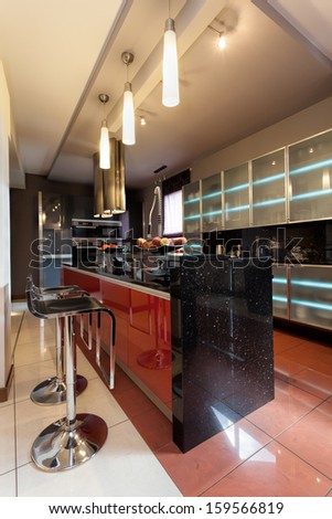 Vertical photo of kitchen counter with bar chairs - stock photo