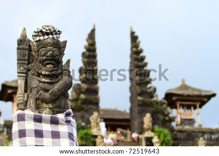 Vertical photo of old beautiful stone Balinese statue in Besakih temple in Bali