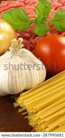 Vertical photo of raw ingredients for spaghetti - stock photo