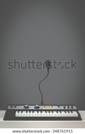vertical photo of studio music synthesizer keyboard & dynamic microphone on grey background + art filter - stock photo
