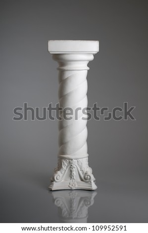 vertical photo one white column   on gray background - stock photo