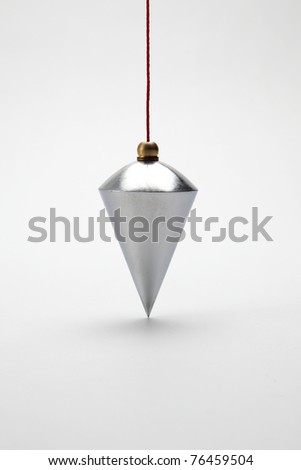 Vertical plumb on white background - stock photo