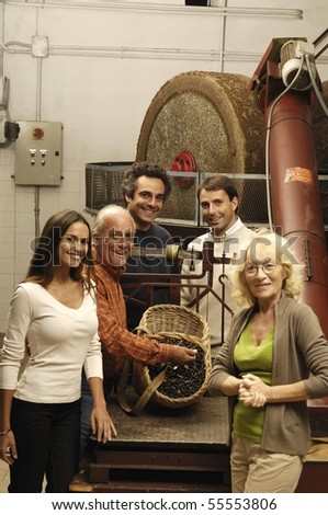 Vertical portrait of a family in a mill - stock photo