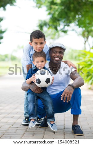 Vertical portrait of a modern sportive family posing at camera  - stock photo
